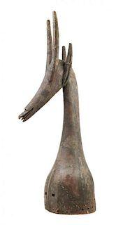 * A Kurumba Wood Headdress Height 39 3/4 inches.