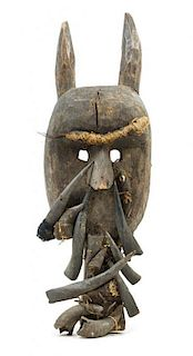 * A Toma Wood and Boar's Tusk Mask Height 28 inches.