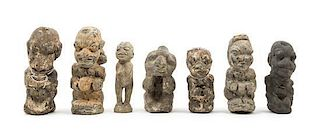 * A Group of Seven Stone Figures Height of tallest 8 3/4 inches.