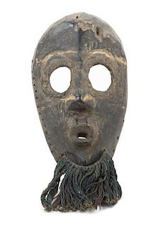 * A Dan Poro Society Wood Mask Height 11 inches.