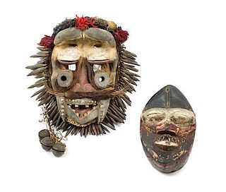 * Two Wobe Wood Masks Height of taller example 16 inches.
