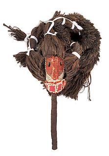 * A Senufo Wood and Raffia Mask and Costume Length overall 102 inches.