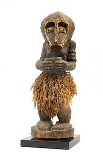 * A Baule Wood and Raffia Monkey Figure Height 18 1/2 inches.