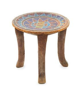 * An Asante Beaded and Carved Wood Chief's Stool Height 12 1/4 x diameter of top 12 7/8 inches.
