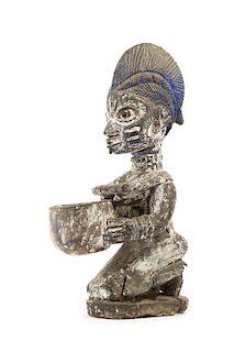 * A Yoruba Wood Figure Height 14 1/2 inches.
