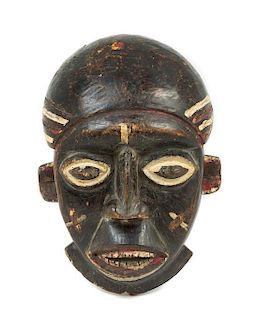 * A Babanki Wood Mask Height 13 3/8 inches.