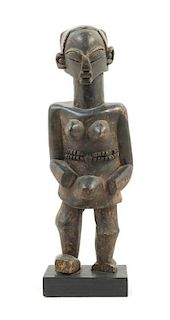 * A Luba Wood Female Figure Height 18 3/4 inches.