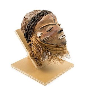 * A Pende Wood and Raffia Initiation Ceremony Mask Height 13 3/4 inches.