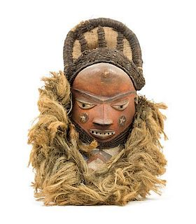 * A Pende Boy's Initiation Mask Height 16 1/2 inches.