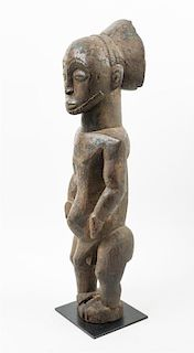 * A Hemba Wood Figure Height 27 1/2 inches.