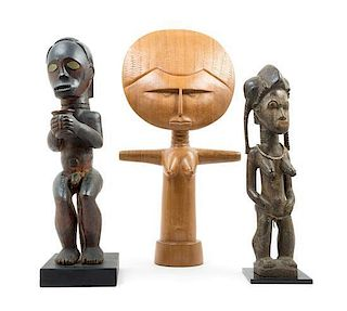 * A Group of Three Wood Figures Height of tallest 24 1/4 inches.