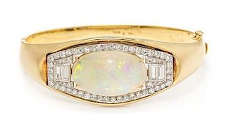 An 18 Karat Yellow Gold, Opal and Diamond Bangle Bracelet, 35.50 dwts.