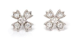 * A Pair of Platinum and Diamond Floret Snowflake Earrings, 1.90 dwts.