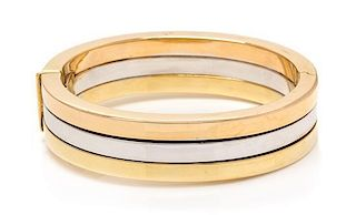 * An 18 Karat Tricolor Gold Bangle Bracelet, Roberto Coin, 28.30 dwts.
