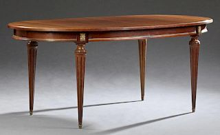 Louis XVI Style Carved Mahogany Ormolu Mounted Dining Table, 20th c., the stepped oval top over a wide skirt, on turned taper