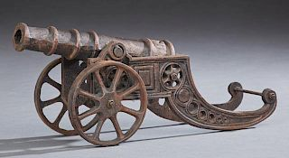 "Cast Iron Scale Model of a Cannon, 20th c., with a sled-form pierced carriage, the rear of the barrel with a relief ""S,"" H.-"