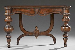 Continental Style Carved Mahogany Console Table, 20th c., the stepped cookie corner top on large turned tapered front legs, a