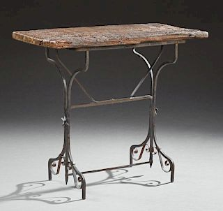 Rustic Aged Wood and Iron Bistro Table, early 20th c., the rough hewn rectangular top on an iron trestle base, H.- 30 1/8 in.
