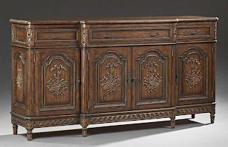 Louis XVI Style Carved Mahogany Sideboard, 20th c., the rounded edge breakfront top over a center long frieze drawer above tw