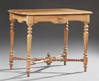 French Louis Philippe Style Carved Walnut Writing Table, early 20th c., the stepped shaped top over an arched skirt with a fr