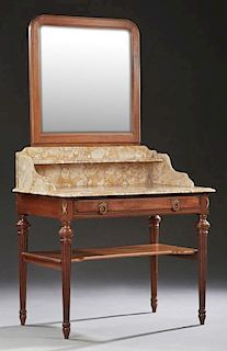 French Carved Mahogany Louis XVI Style Marble Top Washstand, early 20th c., with an arched mirror over a highly figured ocher