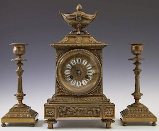 Diminutive French Louis XVI Style Gilt Bronze Three Piece Clock Set, 19th c., the time and strike clock with a covered tureen