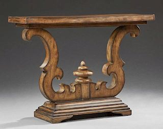 Carved Walnut Console Table, 20th c., the rectangular top raised on serpentine scrolled supports, to a stepped base on bracke