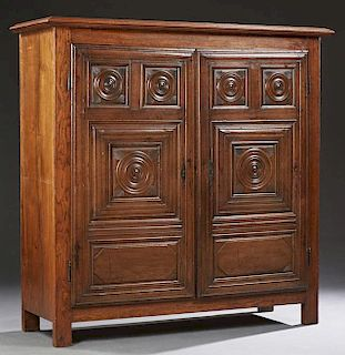 Diminutive French Carved Oak Louis XIII Style Armoire, early 19th c., the stepped crown over double doors with relief carved