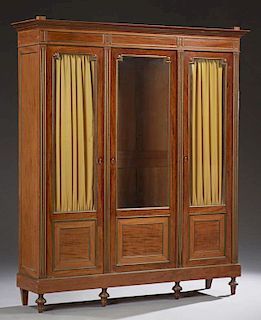 French Louis XVI Style Carved Mahogany Ormolu Mounted Armoire, 19th c., the stepped top with turned finials, above a paneled