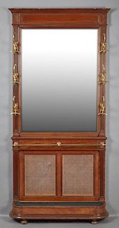 French Carved Mahogany Hall Stand, 19th c., the stepped crown over a wide beveled mirror flanked by reeded stiles with six br