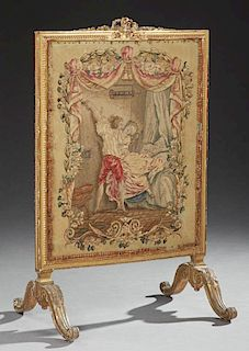 French Louis XVI Style Giltwood Fire Screen, 19th c., the pierced bow carved crest over a relief carved frame around an Aubus