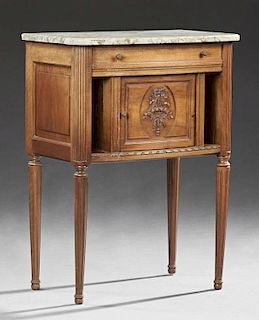 French Louis XVI Style Carved Walnut Marble Nightstand, early 20th c., the rounded edge highly figured creme marble over a fr