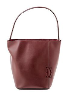 """A Cartier Burgundy Calfskin Must-C Bucket Bag, 8"""" x 11"""" x 7.5""""; Handle drop: 9""""."""
