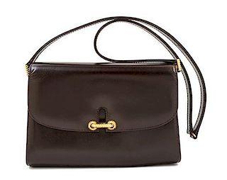 "A Gucci Dark Brown Leather Flap Handbag, 8"" x 6"" x 2""; Strap drop: 14""."