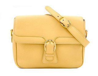 """* A Gucci Pale Yellow Leather Flap Handbag, 10"""" x 8"""" x 3""""; Strap drop: 20""""."""