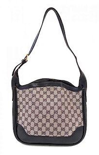 """A Gucci Blue Monogram Shoulder Bag, 11"""" x 9.5"""" x 3""""; Strap drop: 10""""."""