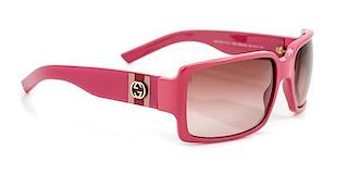 A Pair of Gucci Pink Framed Sunglasses,