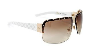 A Pair Of Gucci Sunglasses,