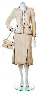An Adolfo Cream, Gold and Navy Knit Skirt Ensemble, No size. Handbag: 8.5'' x 6''; Strap drop: 10.5''.