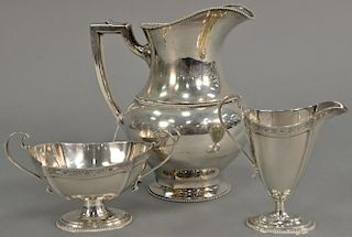 Three piece lot to include sterling silver pitcher (ht. 8 in.), Hardy Bros. Ltd. sugar and creamer. 25.5 troy ounces   Proven