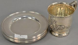 Nine piece lot to include eight bread plates (dia. 6in.) and Theodore Starr mug (ht. 3 1/2in.). 34.2 troy ounces
