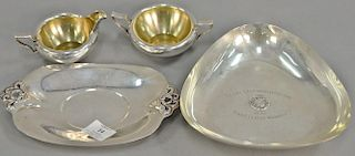Sterling silver five pieces with dishes (lg. 7 1/2 in. & 9 in.), pourer, cream, and sugar. 27 troy ounces   Provenance: The E