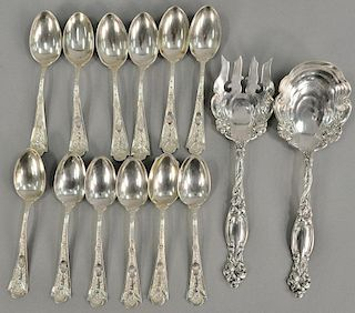 Fourteen piece sterling silver lot including two piece salad set and twelve bright cut spoons. 14.5 troy ounces