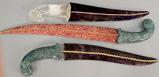 Three Asian daggers including two with carved jade handles (lg. 16in. & 20in.) and one with rock crystal ram's head handle (l