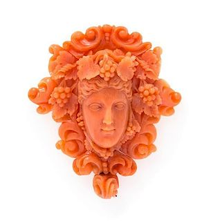 An Antique Carved Coral Bacchante Pendant/Brooch, 12.80 dwts.