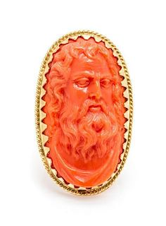 An 18 Karat Yellow Gold and Coral Cameo Ring, 8.60 dwts.
