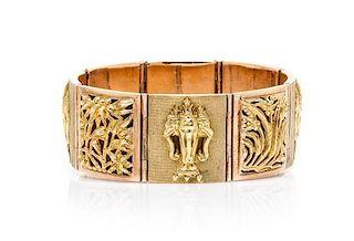 An 18 Karat Yellow Gold Cuff Bracelet with Floral Motif, 44.60 dwts.