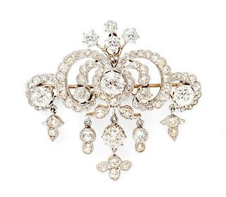 An Edwardian Platinum Topped Gold and Diamond Pendant/Brooch, 12.90 dwts.