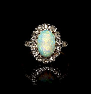 An Edwardian Platinum Topped Gold, Diamond and Opal Ring, 2.45 dwts.