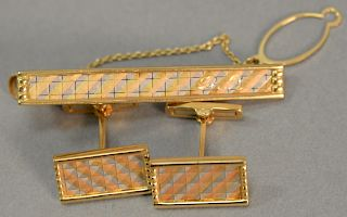 Three piece Mitsubishi 18 karat lot to include cufflinks and tie clip with multicolor surfaces, monogrammed: DR